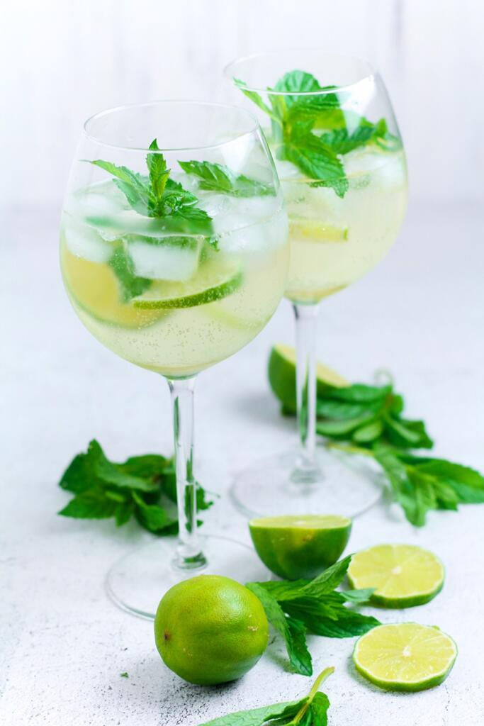 Wildly popular across Europe, the Hugo Spritz cocktail is a refreshing mixture of lime, mint, elderflower and sparkling wine. Served over ice in a large wine glass, this is the perfect drink on a sunny day.